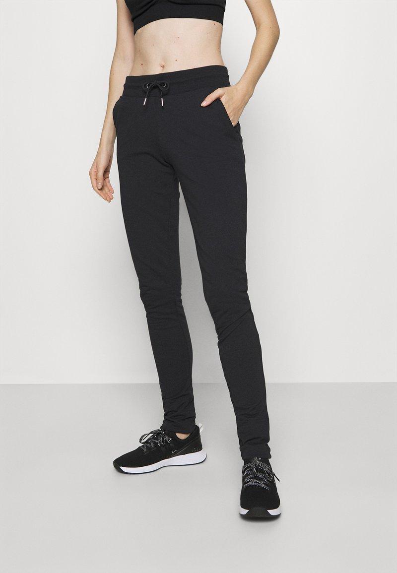 Fila - KARLA - Teplákové kalhoty - black