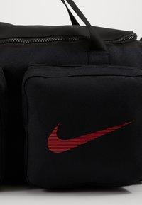 Nike Performance - UTILITY S DUFF - Sports bag - black/track red - 6