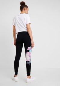 Desigual - PORTRAIT - Leggings - Trousers - black - 2