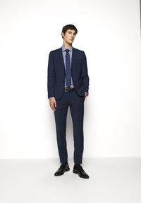 HUGO - HESTEN - Pantaloni eleganti - open blue - 1