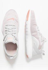 Nike Performance - FLEX TRAINER 9 - Kuntoilukengät - vast grey/pink quartz/echo pink/white - 1