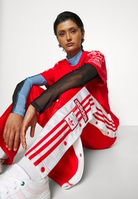 adidas Originals - ADIBREAK - Pantalones deportivos - red - 5