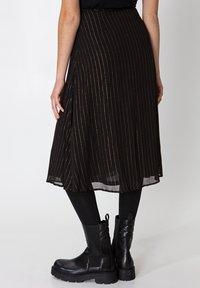 Indiska - ROS LUREX - A-line skirt - black - 2