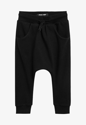 STONE DROP CROTCH - Tracksuit bottoms - black