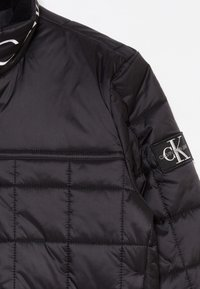 Calvin Klein Jeans - SQUARE QUILT LIGHT  - Winter jacket - black - 4