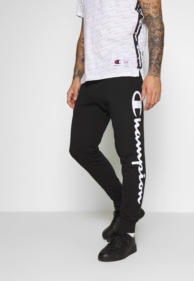 Champion - BIG LOGO CUFF PANTS - Verryttelyhousut - black