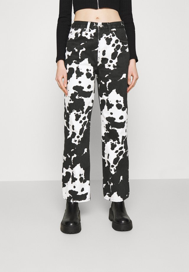 COW PRINT RUNWAY - Jeans relaxed fit - black/white