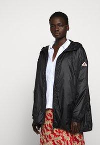 PYRENEX - WATER REPELLENT AND WINDPROOF - Waterproof jacket - black - 4