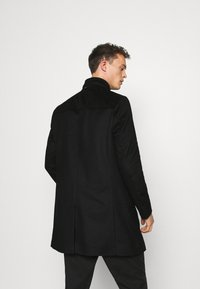 Tommy Hilfiger Tailored - SOLID STAND UP COLLAR COAT - Manteau classique - black - 2