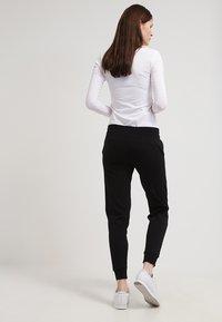Zalando Essentials - Pantaloni sportivi - black - 2