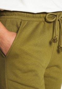 Vero Moda - VMMERCY PANT - Tracksuit bottoms - fir green - 4