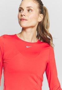 Nike Performance - ALL OVER - Koszulka sportowa - track red/white - 4