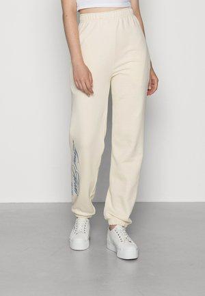 Teplákové kalhoty - ivory