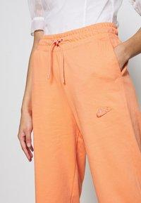Nike Sportswear - W NSW CAPRI JRSY - Joggebukse - orange trance - 4