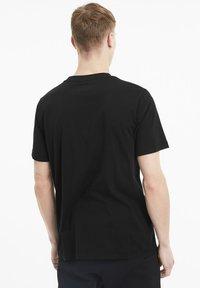 Puma - LOGO TEE - Print T-shirt - black - 2