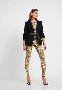 Missguided - HALLOWEEN LEOPARD PRINT SCOOP BACK - Jumpsuit - brown - 1