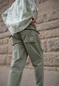 Carhartt WIP - HURST PANT - Tracksuit bottoms - dollar green - 2