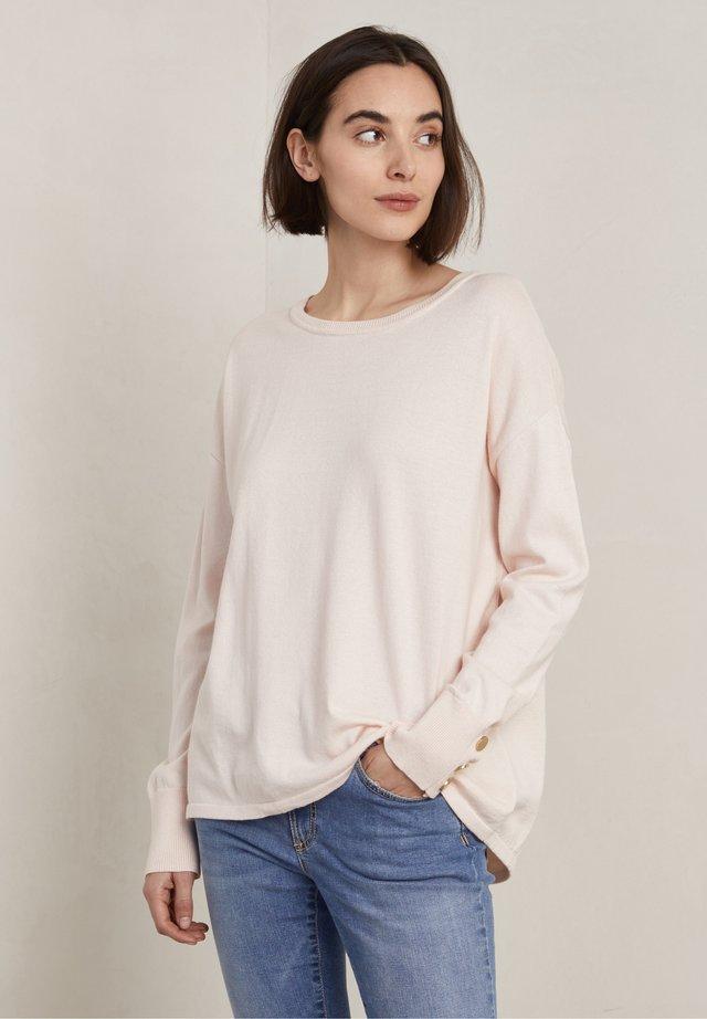 Stickad tröja - soft rose