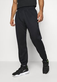 Nike Performance - SPOTLIGHT PANT - Tracksuit bottoms - black - 0