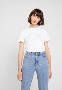 Calvin Klein Jeans - REVERSED LOGO MODERN SLIM TEE - Print T-shirt - bright white - 0