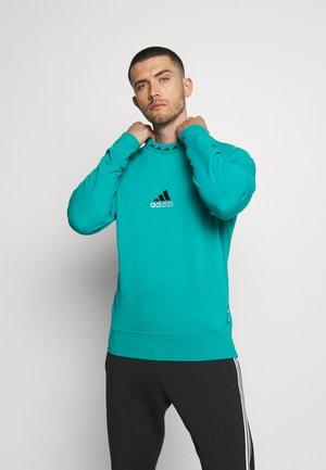 REAL MADRID ICON - Club wear - blast emerald