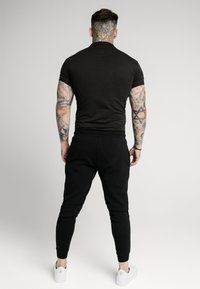 SIKSILK - INSET CUFF STRETCH - Polo shirt - black