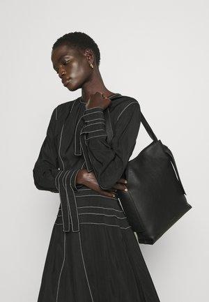 ANGELA TOTE - Handbag - black