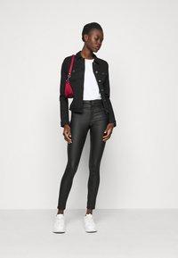 Vero Moda Tall - VMHOT SOYA JACKET - Denim jacket - black - 1