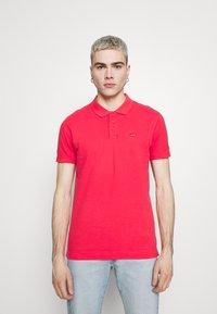 Levi's® - O.G BATWING POLO - Polo shirt - paradise pink - 0