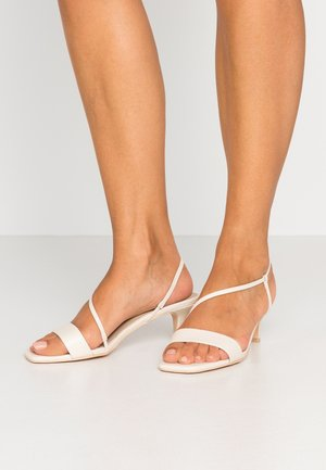 CROSS STRAPPED HEEL  - Sandals - creme