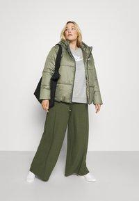 Nike Sportswear - CLASSIC TAPE - Winter jacket - medium olive/black/white - 1