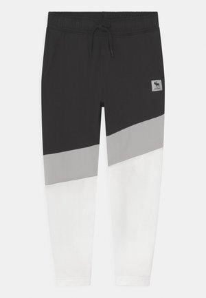 ESPORTS SYNTHETIC TAPER - Pantaloni sportivi - black