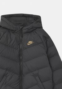 Nike Sportswear - UNISEX - Winter jacket - black/metallic gold - 2