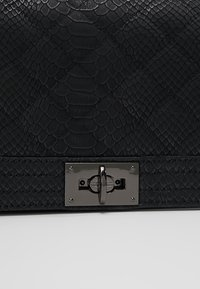 Gina Tricot - MIA BAG - Across body bag - mottled black - 6