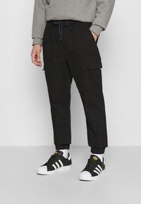Tommy Jeans - JOGGER - Cargo trousers - black - 0