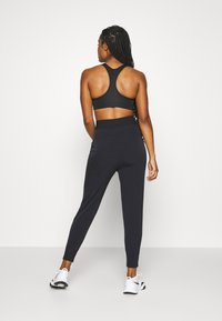 Nike Performance - BLISS - Tracksuit bottoms - black - 2