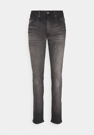 SKINNY TAPER - Jeans Skinny Fit - greys