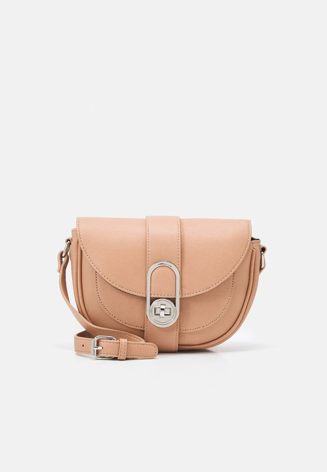 CADITWISTLOCK SADDLE CROSS BODY BAG - Across body bag - nude