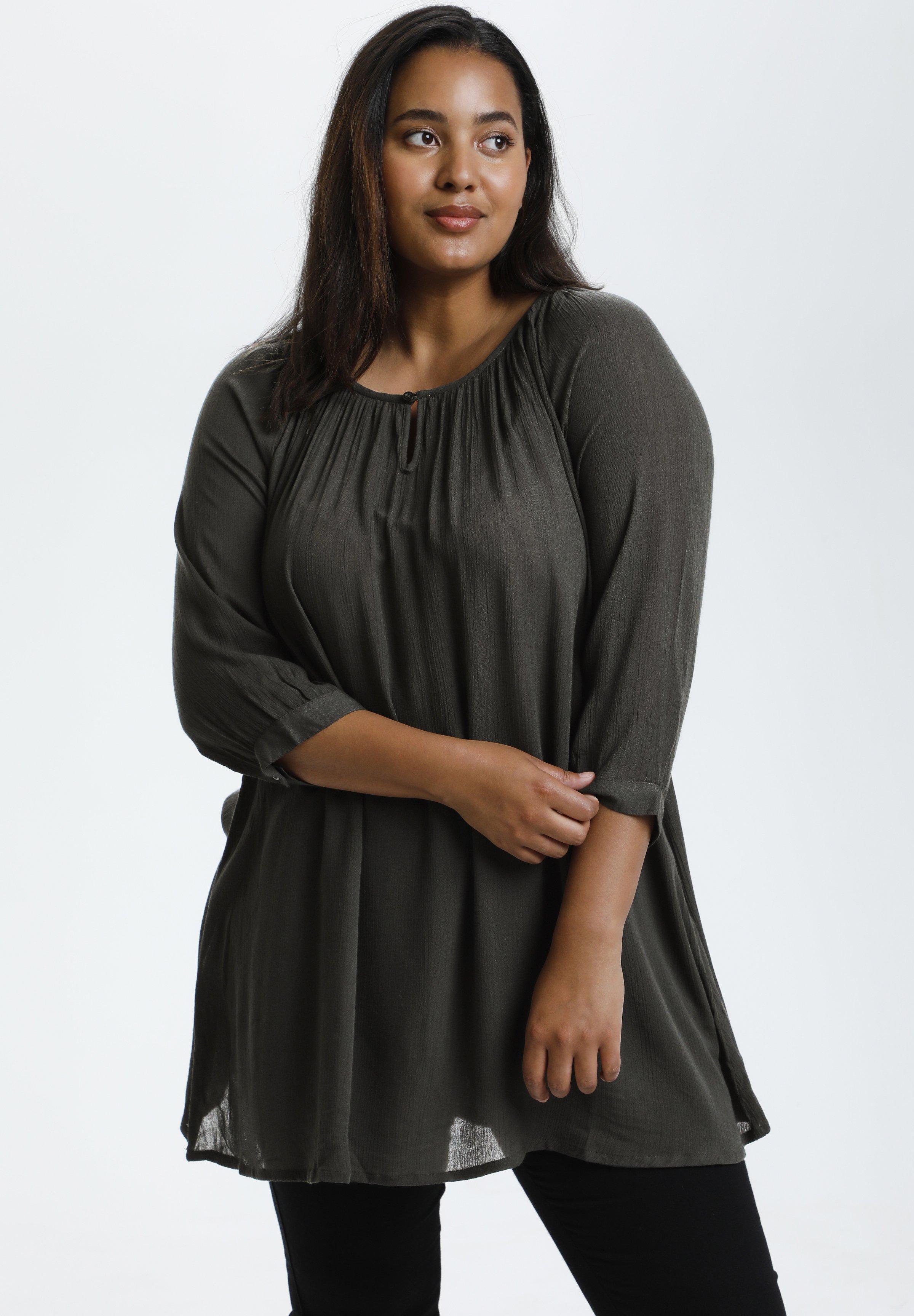 Donna KCAMI - Tunica