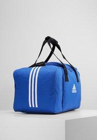adidas Performance - Sports bag - bold blue/white - 3