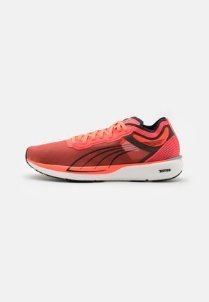 LIBERATE NITRO - Neutral running shoes - lava blast/white