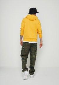 Levi's® - NEW ORIGINAL HOODIE  - Hoodie - yellows/oranges - 2