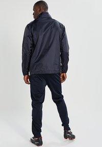 JAKO - TEAM - Waterproof jacket - marine - 2