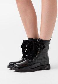 KHARISMA - Šněrovací kotníkové boty - nero - 0