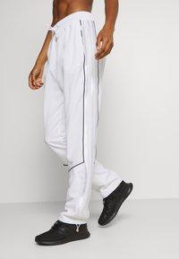 adidas Performance - AEROREADY SPORTS BASKETBALL PANTS - Pantalones deportivos - white - 4