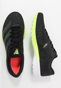 adidas Performance - ADIZERO BOUNCE SPORTS RUNNING SHOES - Zapatillas de competición - core black/signal green - 1