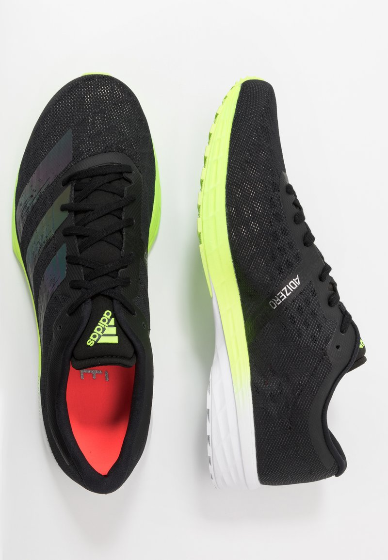 Mediante George Eliot terminar  adidas Performance ADIZERO BOUNCE SPORTS RUNNING SHOES - Zapatillas de  competición - core black/signal green/negro - Zalando.es