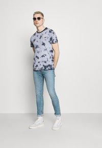 Levi's® - 512™ SLIM TAPER LO BALL - Slim fit jeans - light blue denim - 1