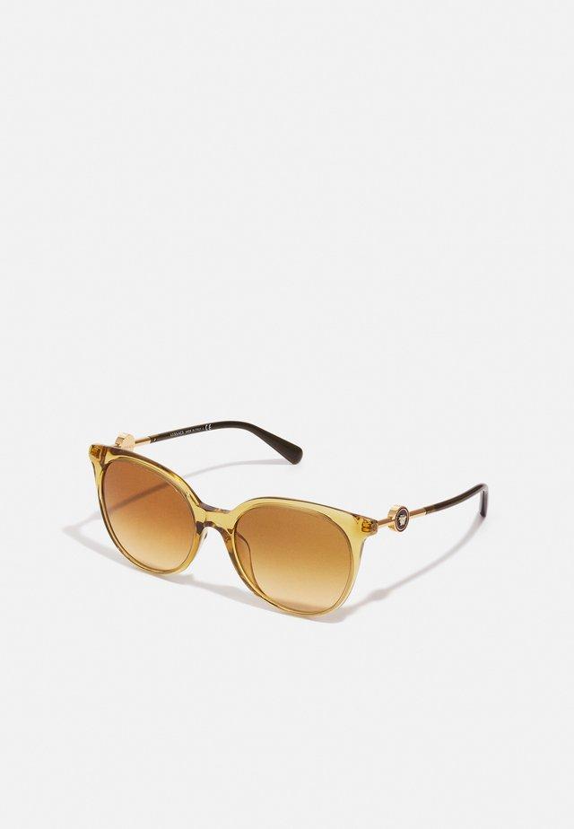 Sluneční brýle - transparent honey