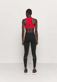 ASICS - WINDBLOCK TIGHT - Leggings - performance black - 2